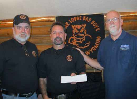 Tom Kostreba and Rick Young, Founders of 'Bad Boys Riding Club,' presenting Jack Welch (right) with a check for $1.000.