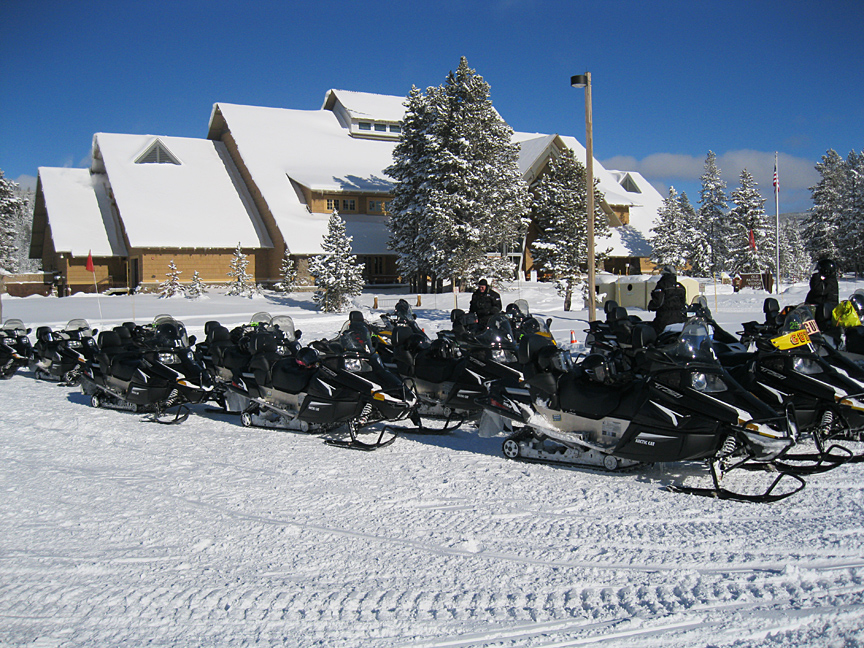 Guided snowmobile tour group prepares to set out from Flagg Ranch to Yellowstone National Park.