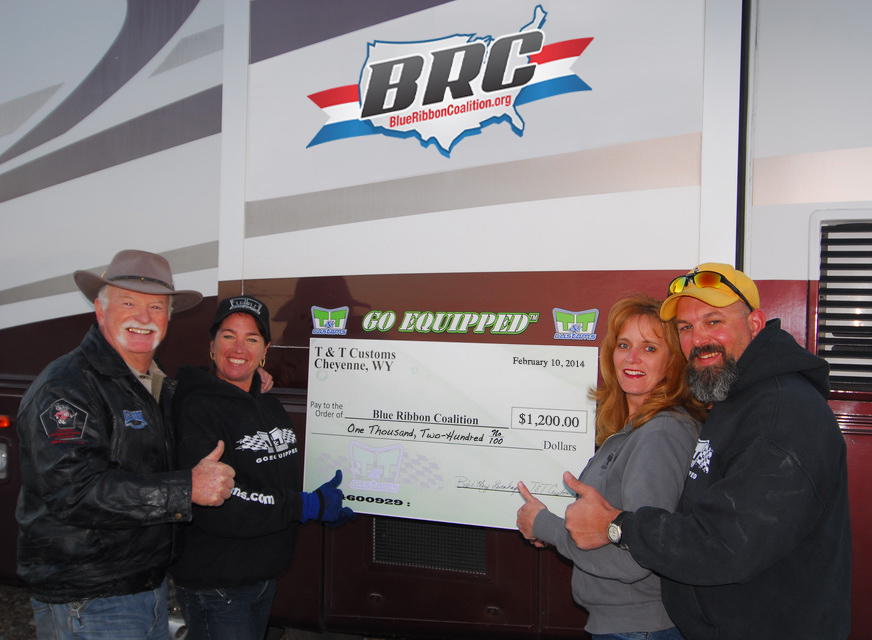 Del & Stacie Albright (left) receive a $1,200 check from Bob and Mary Levenhagen
