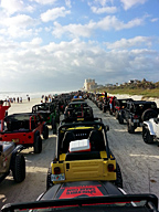 Del and Stacie drove the donated Jeep down the beach with over a thousand other Jeeps on the parade at Jeep Beach, thanks to SpiderWebShade.