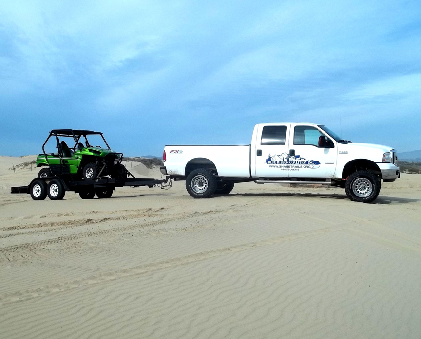 BRC truck and trailer prepares to unload at Oceano Dunes SVRA for tour with OHMVR Division grant staff.